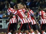 PSV Eindhoven's forward Memphis Depay celebrates with teammates after scoring a goal during the UEFA Europa League group E football between PSV Eindhoven and Panathinaikos Athens at the Apostolos Nikolaidis stadium in Athens on November 6, 2014