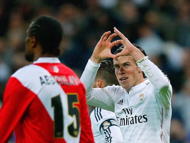 Gareth Bale of Real Madrid CF celebrates scoring their opening goal during the La Liga match between Real Madrid CF and Rayo Vallecano de Madrid at Estadio Santiago Bernabeu on November 8, 2014