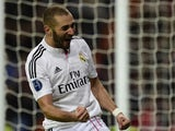 Real Madrid's French forward Karim Benzema celebrates after scoring a goal during the UEFA Champions League group B football match Real Madrid CF vs Liverpool FC at the Santiago Bernabeu stadium in Madrid on November 4, 2014