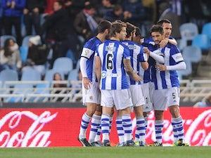 Real Sociedad's players celebrate a goal during the Spanish league football match Real Sociedad vs Atletico de Madrid at the Anoeta stadium in San Sebastian on November 9, 2014