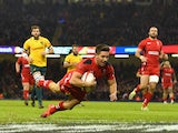 Wales scrum half Rhys Webb breaks through to score the first try during the Autumn international match between Wales and Australia at Millennium Stadium on November 8, 2014