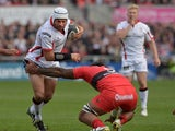 Rory Best of Ulster is tackled by Romain Taofifenua of Toulon during the European Rugby Champions Cup Pool 3 game at the Kingspan stadium on October 25, 2014