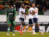 Schalke's Cameroonian forward Eric Maxim Choupo-Moting celebrates with his teammates after scoring during the UEFA Champions League football match Sporting Clube de Portugal vs FC Schalke 04 at the Jose Alvalade stadium in Lisbon on November 5, 2014.
