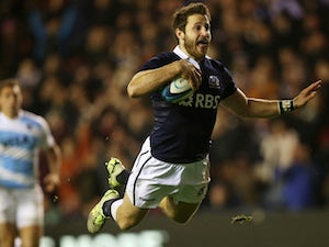 Scotland's wing Tommy Seymour dives in to score a try during the Autumn International rugby union Test match between Scotland and Argentina at Murrayfield Stadium in Edinburgh, Scotland, on November 8, 2014