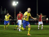 Craig Robinson of Warrington Town celebrates the opening goal during the FA Cup First Round match between Warrington Town and Exeter City at Cantilever Park on November 7, 2014