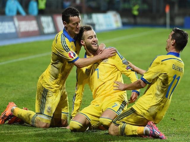 Ukraine's Andriy Yarmolenko (C) celebrates after scoring during the Group C Euro 2016 qualifying football match against Luxembourg on November 15, 2014