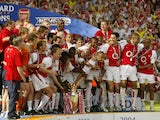 Arsenal celebrates winning the Premiership title and defeating Leicsester City 15 May, 2004