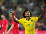 Brazil's forward Willian celebrates after scoring a goal during a friendly football between Turkey and Brazil on November 12, 2014