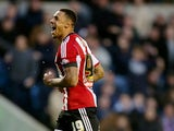 Andre Gray of Brentford celebrates after scoring to make it 2-1 during the Sky Bet Championship match between Millwall and Brentford at The Den on November 8, 2014