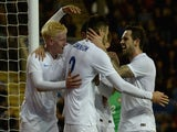 Carl Jenkinson of England celebrates scoring his team's second goal with Will Hughes and Danny Ings during the U21 International Friendly match against Portugal on November 13, 2014