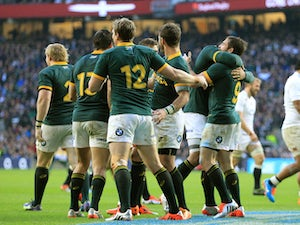 Cobus Reinach of South Africa celebrates after scoring his team's second try of the game during the QBE Intenational match between England and South Africa on November 15, 2014