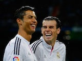 Cristiano Ronaldo (L) of Real Madrid jokes with his teammate Gareth Bale prior to start the La Liga match against Rayo Vallecano on November 8, 2014