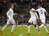 England's striker Danny Welbeck (C) celebrates after scoring his team's second goal during the Euro 2016 Qualifier, Group E football match against Slovenia on November 15, 2014
