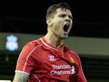 Liverpool's Croatian defender Dejan Lovren celebrates scoring his team's second goal in the League Cup Fourth Round football match against Swansea City on November 13, 2014