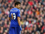 Diego Costa of Chelsea looks on with a ripped shirt during the Barclays Premier League match between Liverpool and Chelsea at Anfield on November 8, 2014