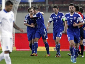 Faroe Island's Joan Edmundsson celebrates with his teammates after scoring a goal during the UEFA Euro 2016 group F qualifying football match between Greece and Faroe Island at the Karaiskaki stadium in Piraeus, near Athens, on November 14, 2014