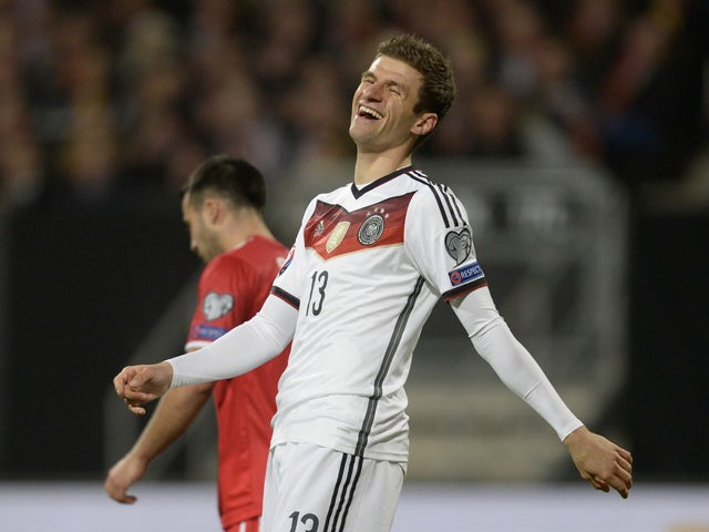 Germany's striker Thomas Muller laughs after the first goal during the UEFA 2016 European Championship qualifying round Group D football match Germany vs Gibraltar in Nuremberg, southern Germany on November 14, 2014