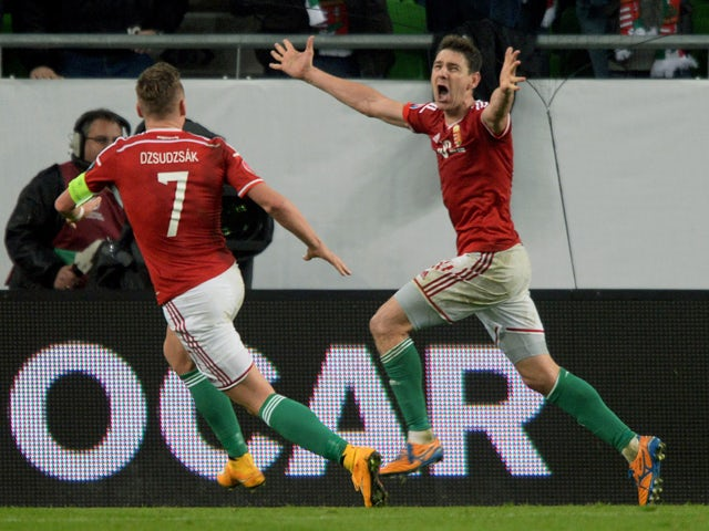 Hungary's midfielder Zoltán Gera celebrates scoring a goal with Hungary's midfielder Balazs Dzsudzsak (L) during the UEFA 2016 European Championship qualifying round Group F football match Hungary vs Finland at the Groupama Arena stadium in Budapest on