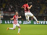 Croatia's midfielder Ivan Perisic (R) celebrates with Croatia's defender Domagoj Vida after scoring during the Euro 2016 qualifying football match Italy vs Croatia on November 16, 2014