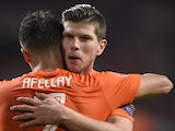 Dutch player Klaas-Jan Huntelaar celebrates with teammate Ibrahim Afellay after scoring during the Euro 2016 qualifying round football match against Latvia on November 16, 2014