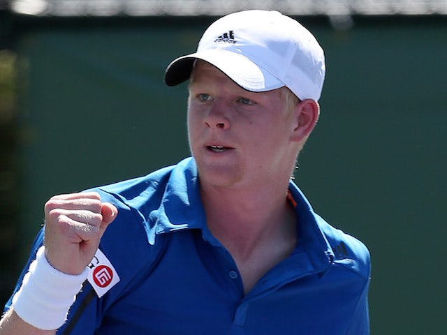 Kyle Edmund of Great Britain celebrates a point against Julien Benneteau of France during their first round match on March 19, 2014