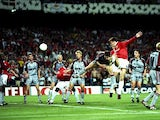 Teddy Sheringham of Manchester United heads goalwards during the UEFA Champions League Final against Bayern Munich at the Nou Camp in Barcelona on 26 May, 1999