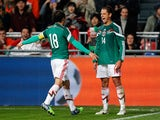 Javier Hernandez #14 of Mexico is congratulated by team mates after scoring the third goal of the game for his team during the international friendly match between Netherlands and Mexico held at the Amsterdam ArenA on November 12, 2014