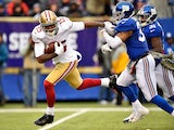 Michael Crabtree #15 of the San Francisco 49ers breaks free from Quintin Demps #35 of the New York Giants on his way to scoring a touchdown on November 16, 2014