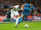 Nathaniel Clyne of England battles with Andraz Kirm of Slovenia during the EURO 2016 Qualifier Group E match between England and Slovenia on November 15, 2014