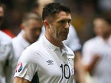 Substitute, Republic of Ireland's striker Robbie Keane leaves the pitch after the Euro 2016 Qualifier, Group D football match against Scotland on November 14, 2014