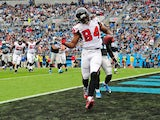 Roddy White #84 of the Atlanta Falcons celebrates after making a catch for a third quarter touchdown against the Carolina Panthers on November 16, 2014