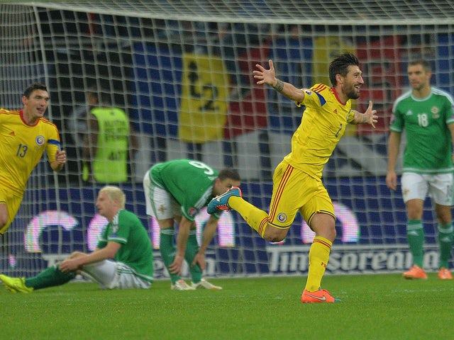 Romania's defender Paul Papp celebrates a goal against Northern Ireland during the UEFA 2016 European Championship qualifying round Group F football match Romania vs Northern Ireland at the Arena Nationala stadium in Bucharest on November 14, 2014