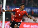 Austria's Rubin Okotie celebrates after scoring a goal during the UEFA 2016 European Championship qualifying round Group G football match against Russia on November 15, 2014