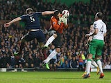 Scotland's defender Grant Hanley vies with Republic of Ireland's goalkeeper David Forde during the Euro 2016 Qualifier, Group D football match between Scotland and Republic of Ireland at Celtic Park in Glasgow, Scotland on November 14, 2014