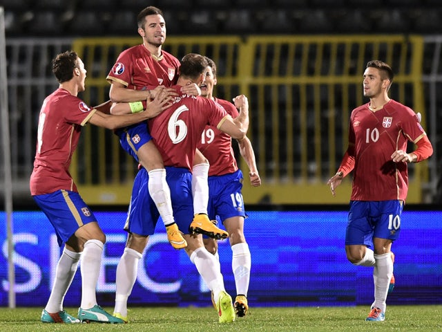 Serbia's striker Zoran Tosic celebrates with teammates after scoring a goal during the EURO 2016 group I football match between Serbia and Denmark in Belgrade on November 14, 2014