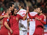 Spain's midfielder Sergio Busquets (2L) celebrates after scoring against Belraus during the UEFA Euro 2016 qualifying football match against Belarus on November 15, 2014