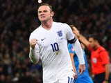 Wayne Rooney of England celebrates as he scores their first and equalising goal from a penalty during the EURO 2016 Qualifier Group E match between England and Slovenia on November 15, 2014