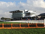 A general view of the grandstand at Wetherby Racecourse and the last hurdle fence before the finish ahead of The bet365 Charlie Hall Meeting on November, 2014