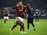 AC Milan's French midfielder Jeremy Menez celebrates after scoring during the Italian Serie A football match between AC Milan and Inter Milan at San Siro Stadium in Milan on November 23, 2014