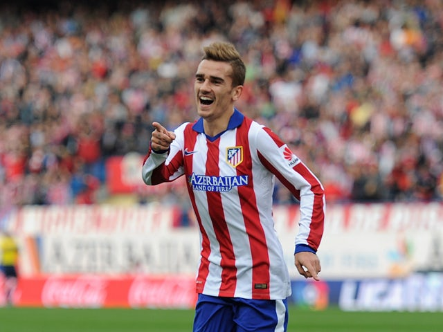 Antoine Griezmann of Club Atletico de Madrid celebrates after scoring his team's 2nd goal during the La Liga match between Club Atletico de Madrid and Malaga CF at Vicente Calderon Stadium on November 22, 2014