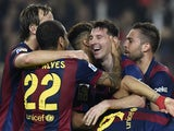Barcelona's Argentinian forward Lionel Messi celebrates with his teammates after setting a new La Liga goalscoring record during the Spanish league football match FC Barcelona vs Sevilla FC at the Camp Nou stadium in Barcelona on November 22, 2014