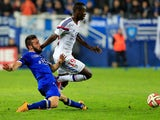 Bastia's French defender Julian Palmieri vies with Lyon's forward Mohamed Yattara during the French L1 football match Bastia (SCB) against Lyon (OL) on November 22, 2014