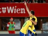 Brazil's forward Neymar and Brazil's midfielder Firmino celebrates scoring during a friendly football match Austria vs Brazil at the Ernst Happel Stadium in Vienna on November 18, 2014