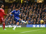 Diego Costa of Chelsea scores the opening goal under pressure from Joleon Lescott of West Brom during the Barclays Premier League match between Chelsea and West Bromwich Albion at Stamford Bridge on November 22, 2014