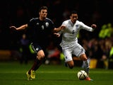 Chris Martin of Scotland and Chris Smalling of England compete for the ball during the International Friendly match on November 19, 2014