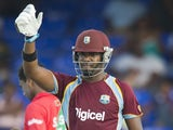 West Indies batman Darren Bravo celebrates his century during the third One Day International against Bangladesh on August 25, 2014