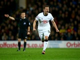 Craig Bryson of Derby County celebrates scoring his sides second goal during the Sky Bet Championship match between Watford and Derby County at Vicarage Road on November 22, 2014