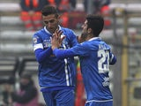 Matias Vecino of Empoli FC celebrates with his team-mate Elseid Hysaj after scoring the opening goal during the Serie A match between Parma FC and Empoli FC at Stadio Ennio Tardini on November 23, 2014