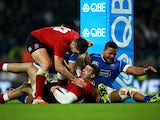 Jonny May of England celebrates with team-mate Brad Barritt of England after scoring a try during the QBE international match between England and Samoa at Twickenham Stadium on November 22, 2014