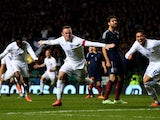 Wayne Rooney of England celebrates after scoring his team's second goal during the International Friendly match between Scotland and England at Celtic Park Stadium on November 18, 2014